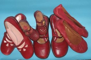 Four pairs of red shoes