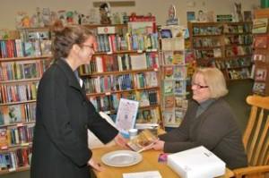Reader buying book